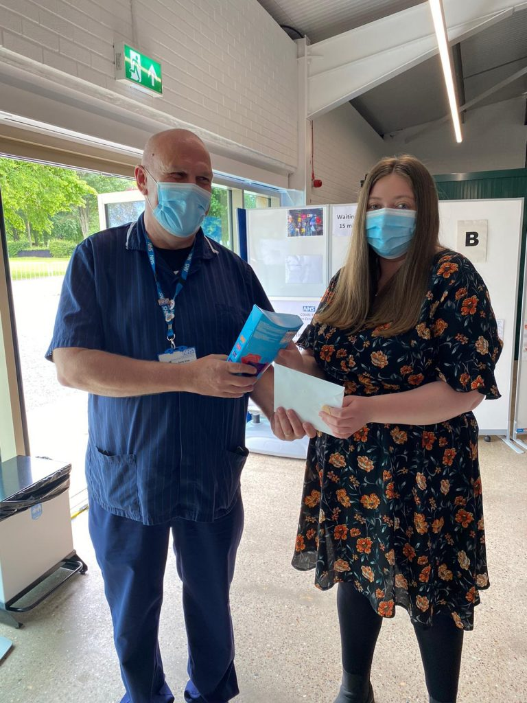 Picture caption: Terry Vine (left hand side of photograph), Clinical and Operational Lead for the Lincolnshire Showground Mass Vaccination Centre, presents chocolates to the recipient of the 100,000th vaccination.
