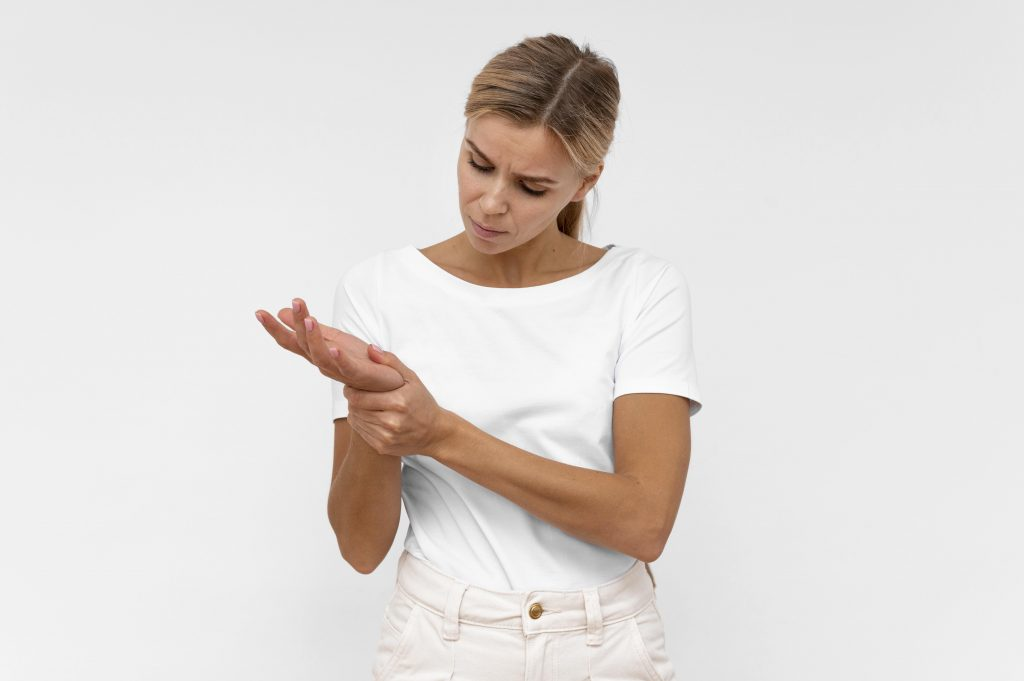 Front view of woman with wrist pain